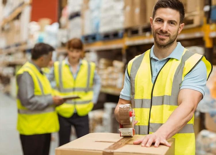 Warehouse Worker sealing a box